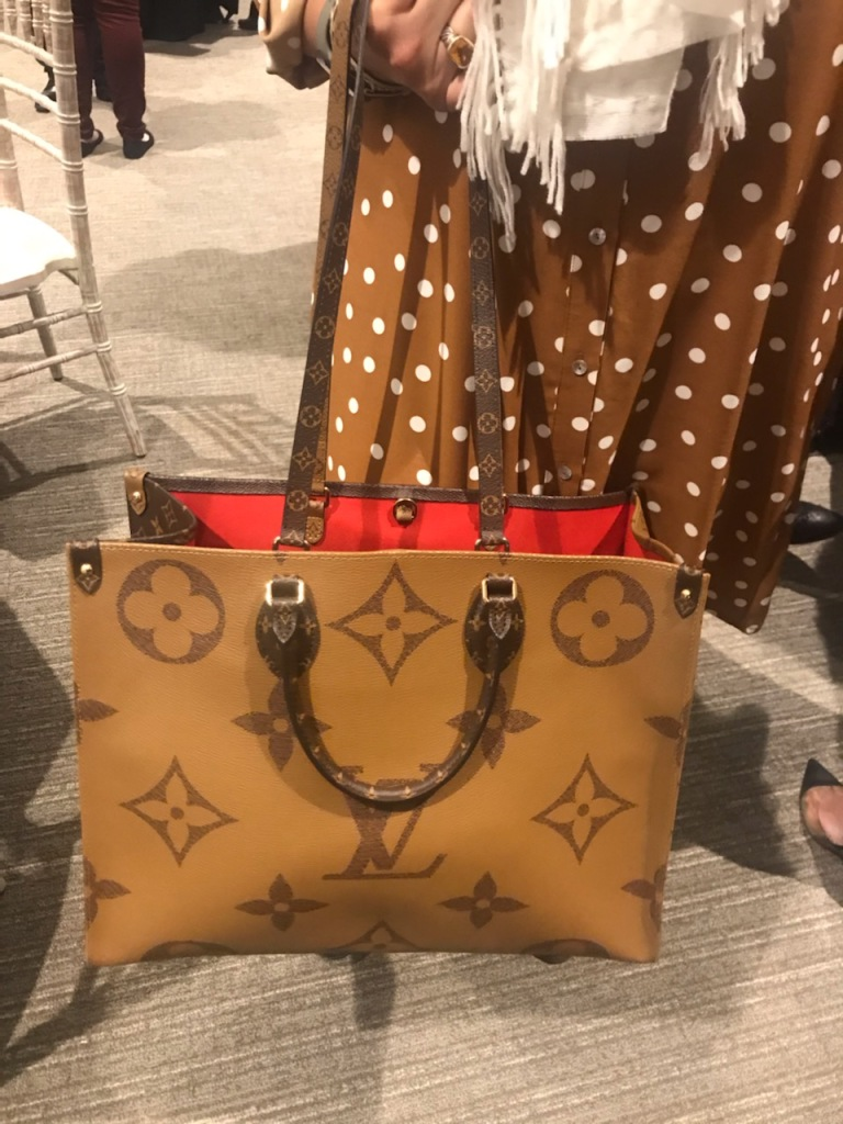 Louis Vuitton OnTheGo reversible tote with iconic Monogram print.